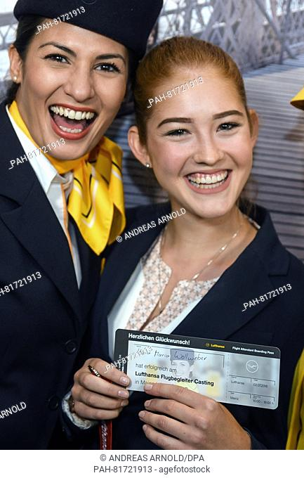 Joana Wollweber (r, 18) holds with great joy next to a flight attendant her successful casting participation in the form of a plane ticket in her hand in Mainz
