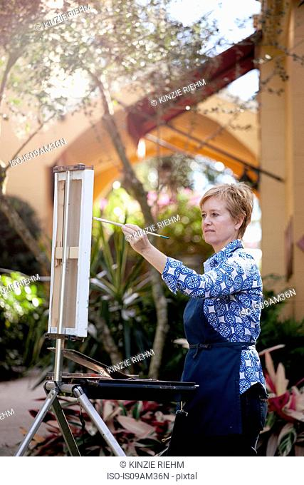 Female artist painting in Albin Polasek Museum and Sculpture Garden, Winter Park, Florida, USA