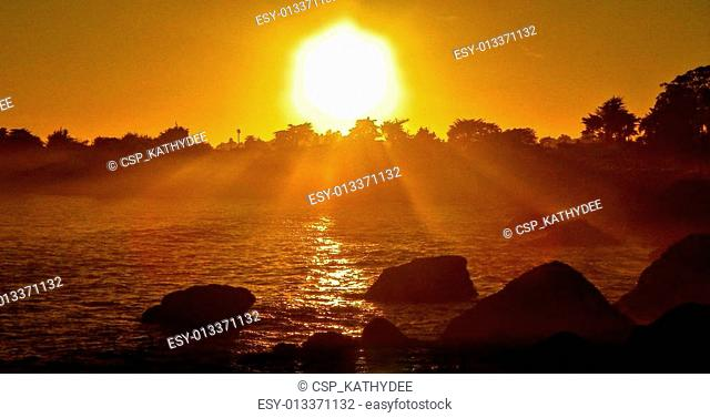intense sunrays on ocean,dusk