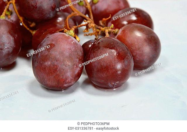red grape on white tile