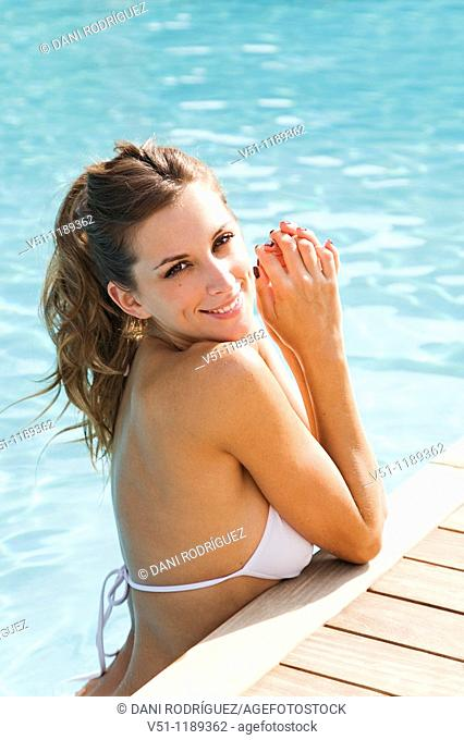 Portrait of a sexy blonde woman enjoying summer holiday in pool