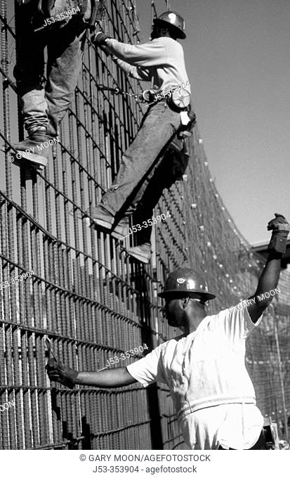 Ironworkers on rebar grid. I-880 Cypress Project. Oakland, California. USA