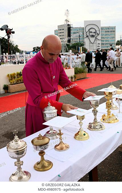 Apostolic journey of Pope Francis (Jorge Mario Bergoglio) to Cuba and the United States of America. A religious man preparing the chalices for the Holy Mass
