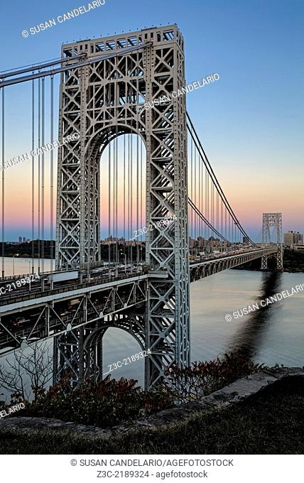 A look a the George Washington Bridge during the rush hour and sunset