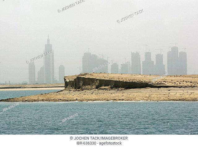 Dubai's skyline see from one of the artificial islands on a man-made world map off the coast of Dubai; each is available for sale in what is part of a building...