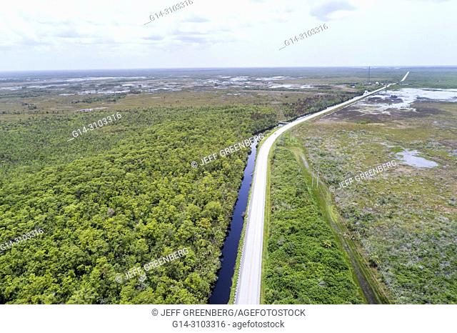 Florida, Carnestown, US Route 29 highway, Big Cypress National Preserve, freshwater marl prairie, canal, aerial overhead bird's eye view above