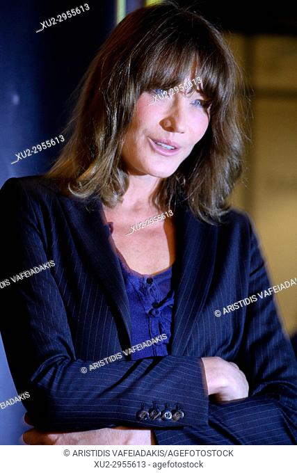 CARLA BRUNI poses for the photographers in Athens. Carla Bruni. The former first lady of France, Carla Bruni begins her world music tour in Athens