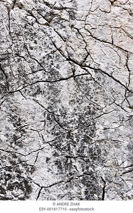 close up texture of grey stone with cracks