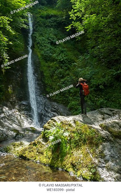 Young photographer in the Lydford Gorge Natural Reserve, Devon, UK