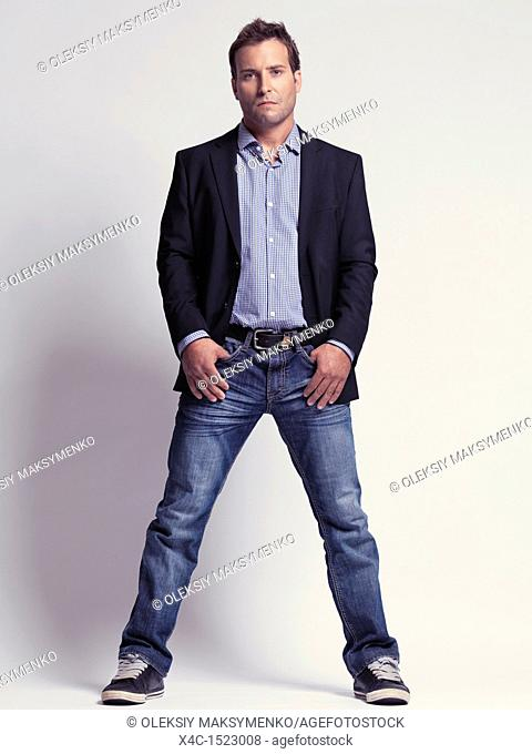 Fashionably dressed man in his thirties wearing jeans and a stylish jacket