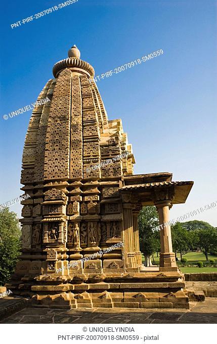 Low angle view of a temple, Kandariya Mahadeva Temple, Khajuraho, Chhatarpur District, Madhya Pradesh, India