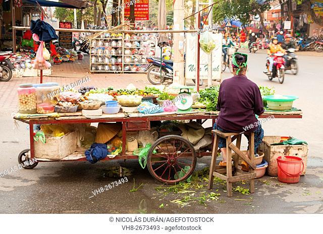 Woman peddler in Hai Phong, Vietnam, Asia