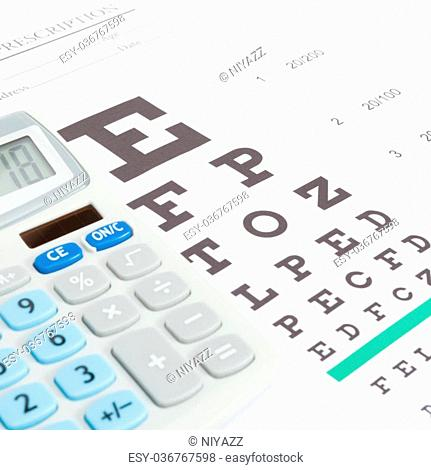 Eyesight test table and medical prescription form with calculator over it