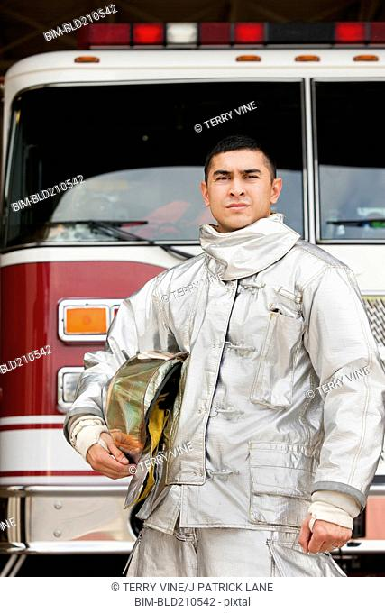 Mixed race firefighter wearing protective gear