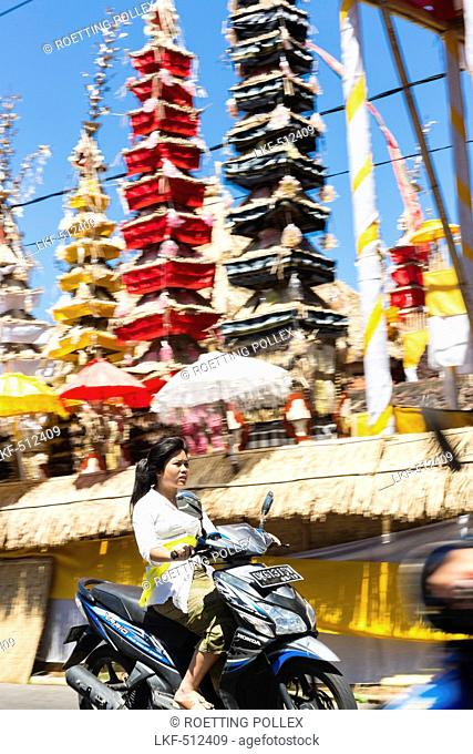Woman riding scooter, Odalan temple festival, Sidemen, Karangasem, Bali, Indonesia