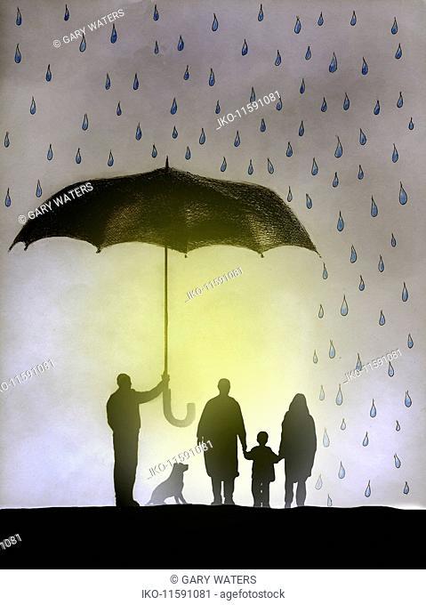 Businessman holding umbrella protecting family