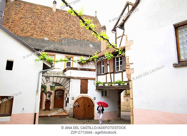 Street scenery in Mittelbergheim, a village of a region in France named Alsace on May 13, 2016. Old winery with tourist