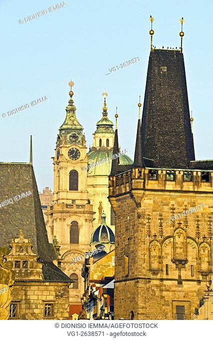 Tower in the foreground on the Charles Bridge, in the background the St. Nicolas church, Prague, Czech Republic, Europe