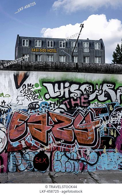 Berlin Wall with graffiti and East Side Hotel, Friedrichshain, Berlin, Germany