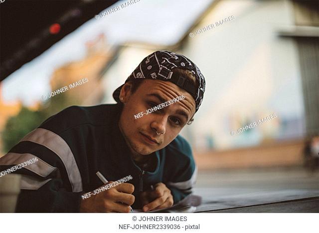Teenage boy looking at camera
