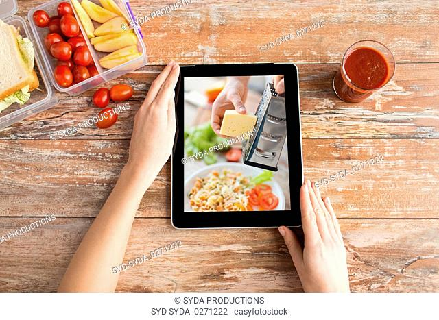 woman watching cooking video on tablet computer