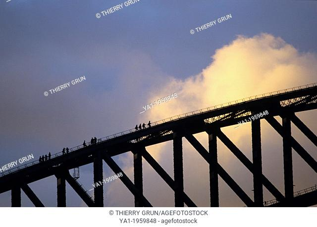 Climbers people on Harbour Bridge at sunset, Sydney, NSW, Australia