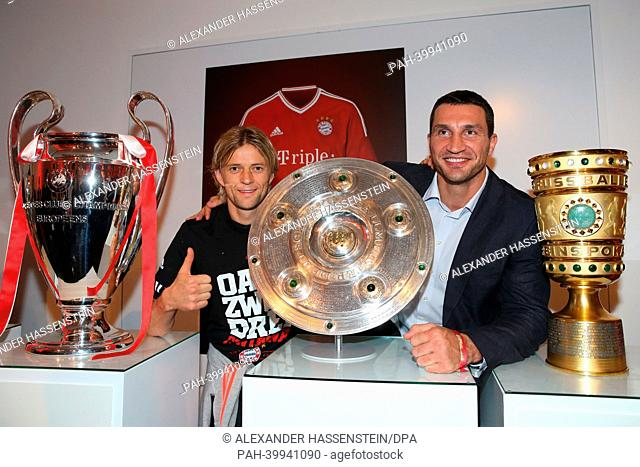 BERLIN, GERMANY - JUNE 01: Anatoliy Tymoshchuk of FC Bayern Muenchen poses with Vladimir Klitschko during the FC Bayern Muenchen Champions party after winning...