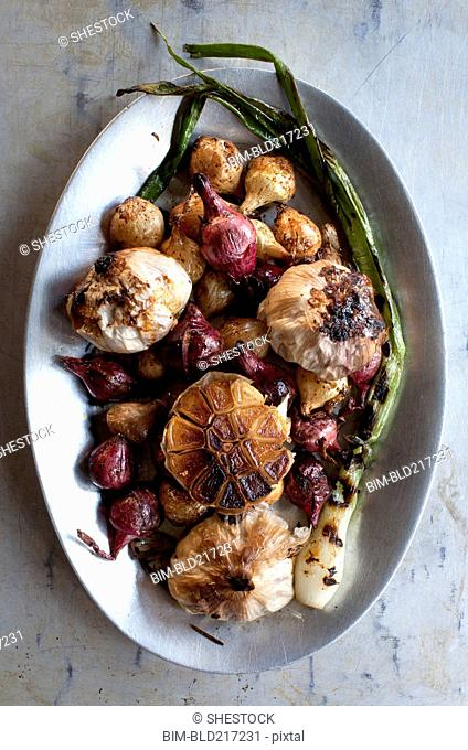 Plate of roast vegetables and garlic