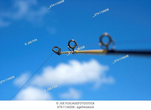 rod and line fishing against blue sky