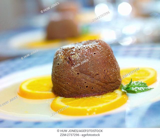 Warm chocolate fondant baked with Gran Marnier sauce
