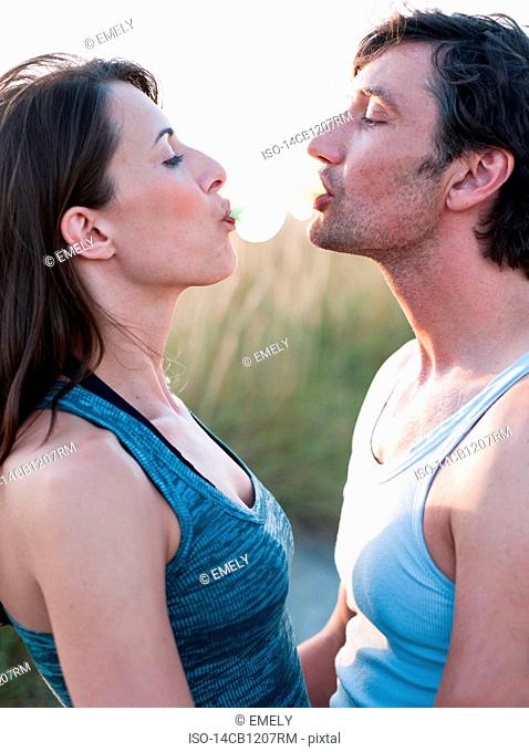couple playing with bubble gum