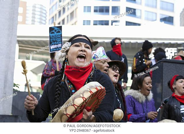 Seattle, Washington: Jennifer Fuentes drums during the Indigenous Peoples' Day March and Celebration at Westlake Park. Fuentes