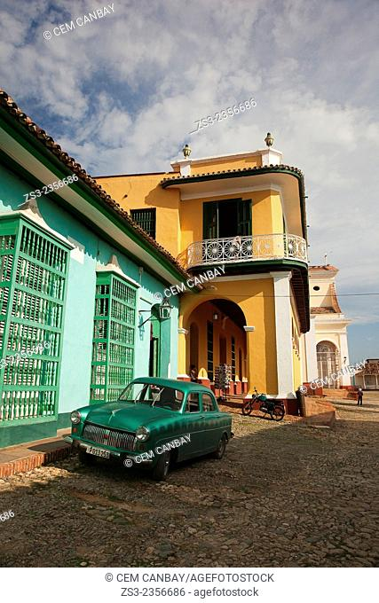 Old american car parked at the street side near Museo Romantico-Romantic Museum in Plaza Mayor, Trinidad, Santi Spiritus, Cuba, West Indies, Central America