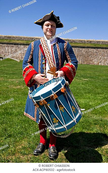 Member of the staff at the Fortress of Louisbourd in period uniform representing a French, 18th Century military drummer