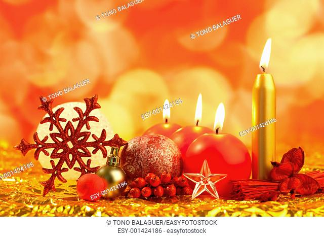 christmas red snowflake with candles on bokeh lights background
