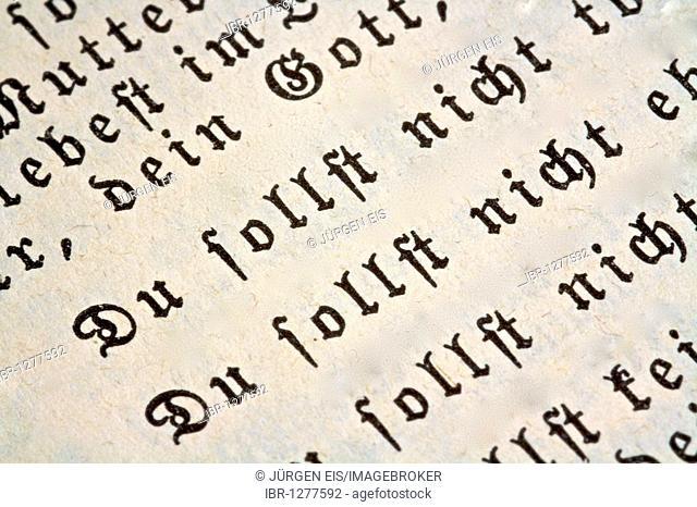The Ten Commandments, detail Thou shalt not .., in an old Bible