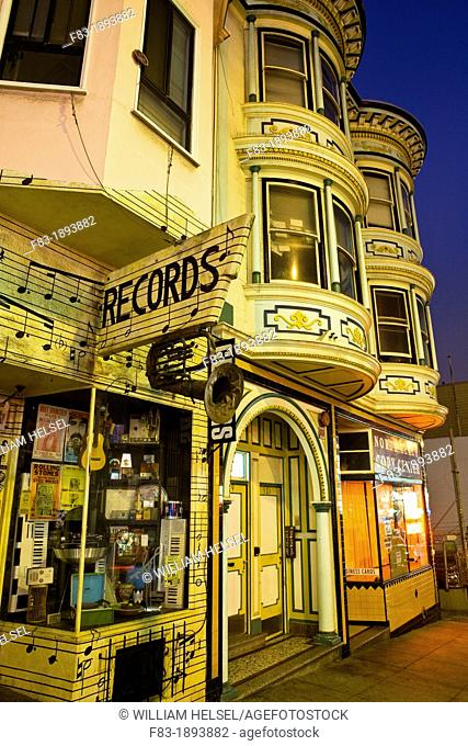 Green Street, North Beach area, San Francisco, California, USA: Victorian style houses with record store 'North Beach Records' and copy shop, night