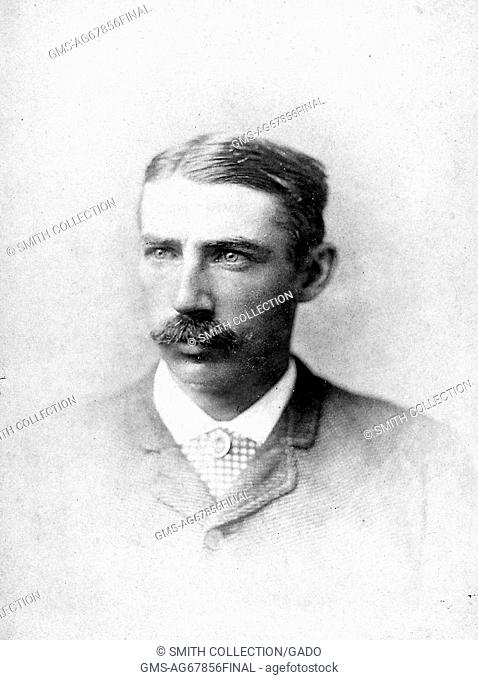 A photographic headshot portrait of Jack Manning wearing a suit, he was a professional baseball player who played twelve seasons for eight teams as a right...