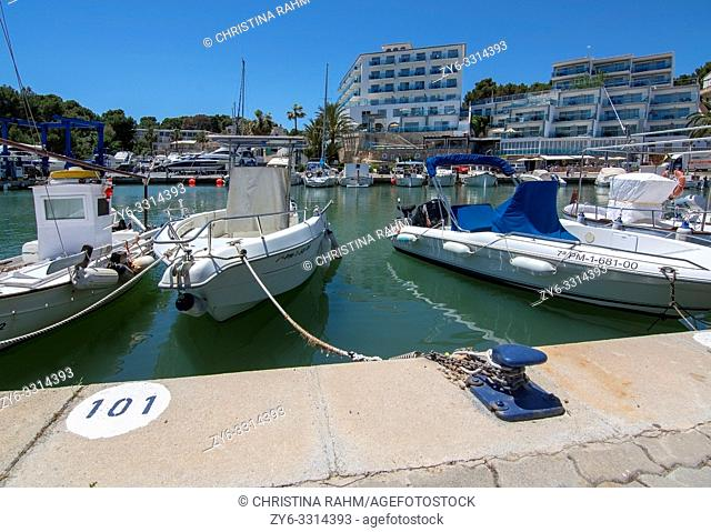 PORTO CRISTO, MALLORCA, SPAIN - MAY 16, 2019: Harbor area with moored small boats on a sunny day on May 16, 2019 in Porto Cristo, Mallorca, Spain