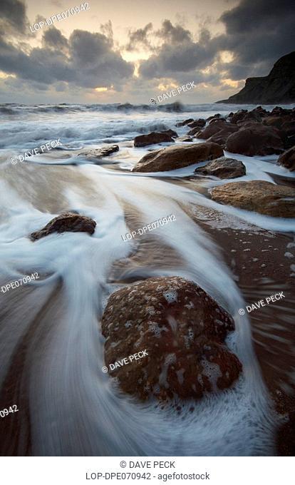England, North Yorkshire, Saltwick Bay, Waves rushing onto the beach at Saltwick Bay