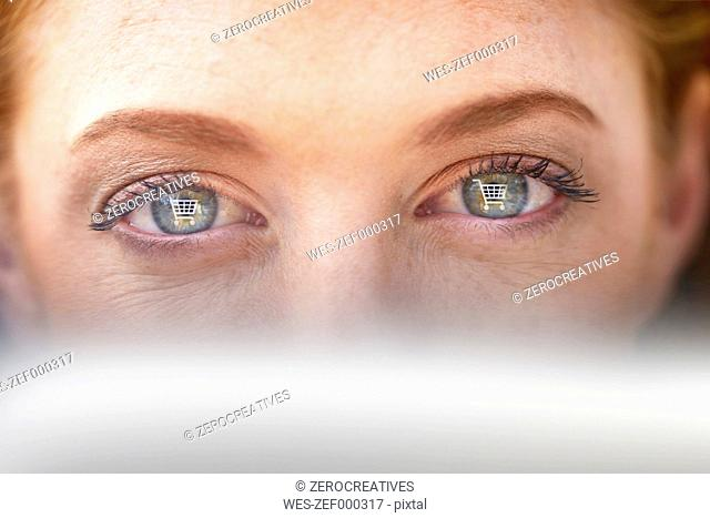 Woman's eyes withshopping cart icons