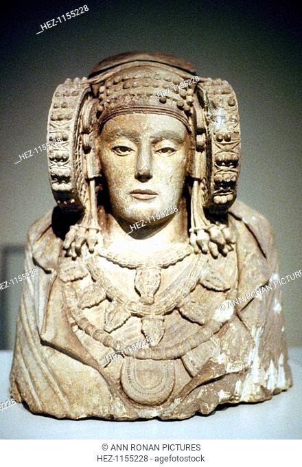 The Lady of Elche, 5th century BC. This painted limestone bust found at La Alcuidia de Elche in Spain in 1897 shows Carthaginian influence on Iberian art of the...