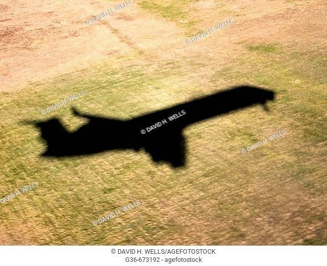 Shadow of a landing jet plane in Providence, Rhode Island, USA