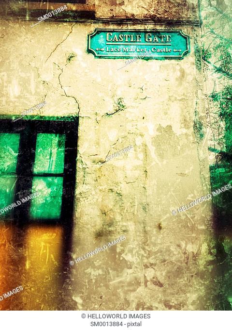 Sign on abandoned building pointing to landmarks, Castle Gate, Nottingham, Nottinghamshire, east Midlands, England