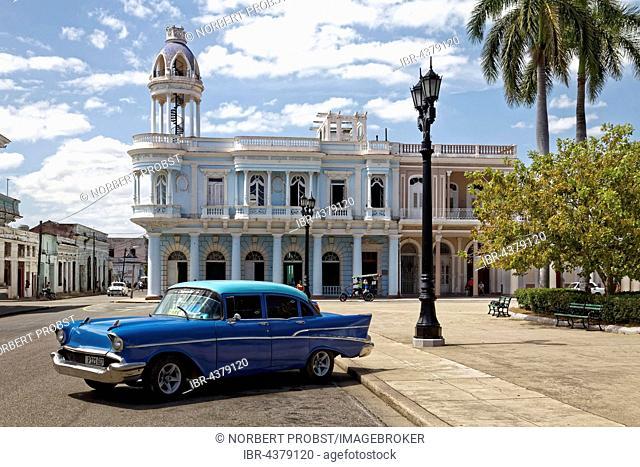Vintage car Chevrolet 1957 Bel Air at Parque Jose Marti, in the background Palacio Ferrer, Casa Provincial de la Cultura, historic city centre, Cienfuegos
