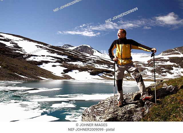 Hiker standing at lake