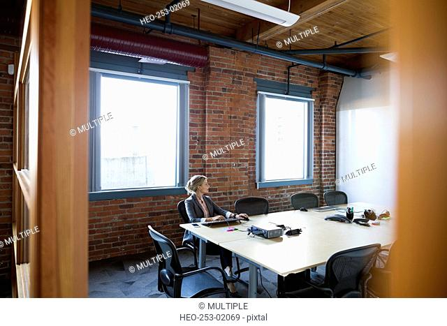 Businesswoman working in conference room
