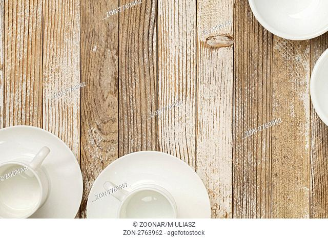 white china espresso coffee cups and other dishware on grunge white painted wood table
