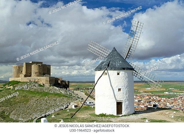 Typical windmill and castle in Consuegra village, in the Route of Don Qiuijote, Toledo province, Castilla-La Mancha, Spain