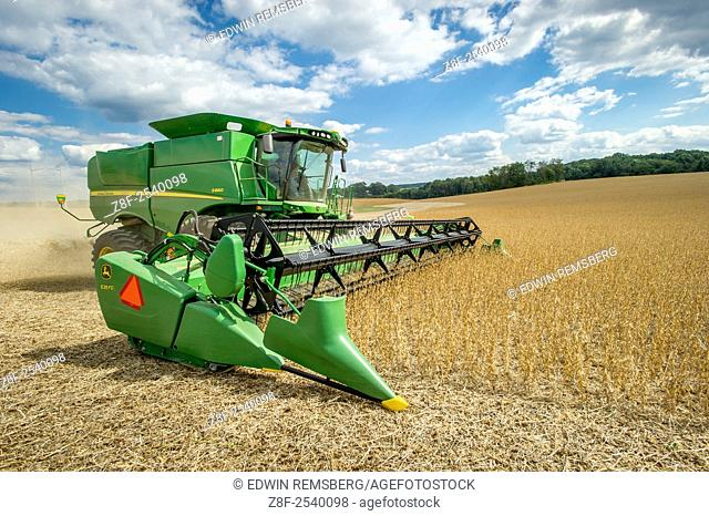 Soybean harvester in in soybean field in Laytonsville, Maryland, USA